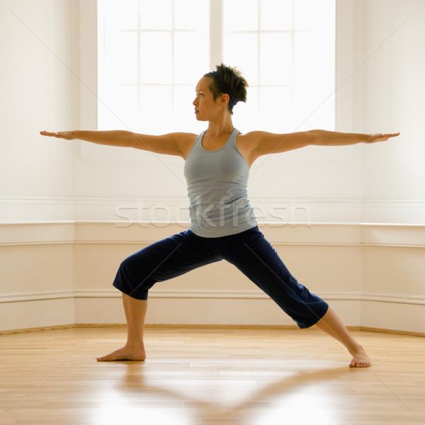Kadın savaşçı poz genç kadın yoga Stok fotoğraf © iofoto