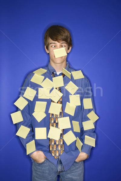 Caucasian teen boy covered with sticky notes. Stock photo © iofoto