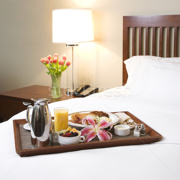 Breakfast tray on white bed. Stock photo © iofoto