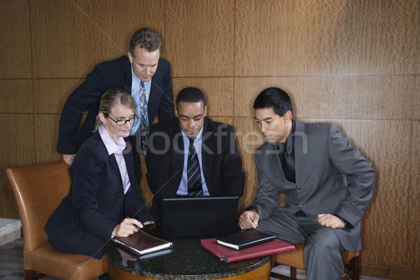 Businesspeople Gathered Around a Laptop Stock photo © iofoto