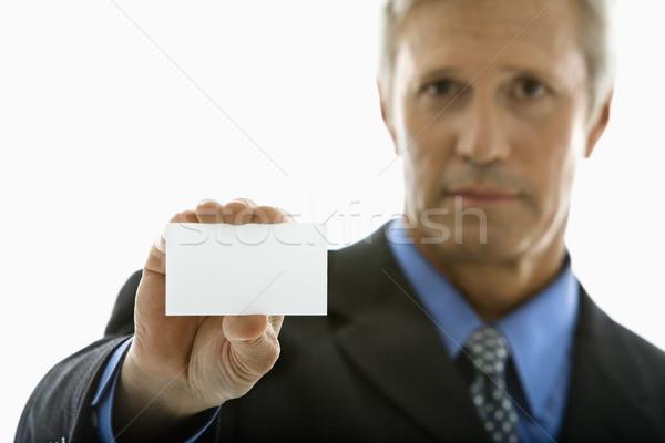Człowiek wizytówkę patrząc Zdjęcia stock © iofoto
