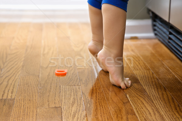 Child on tiptoe. Stock photo © iofoto