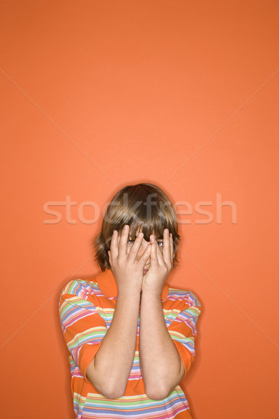 Boy hiding face. Stock photo © iofoto