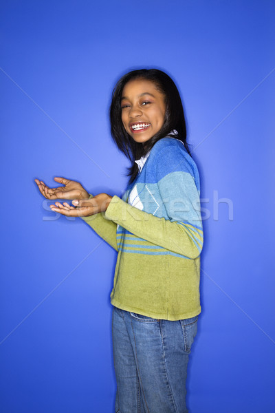 Girl holding out hands. Stock photo © iofoto