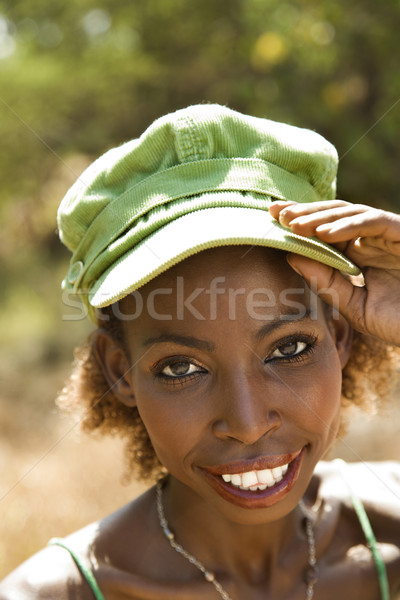 Woman in cap. Stock photo © iofoto
