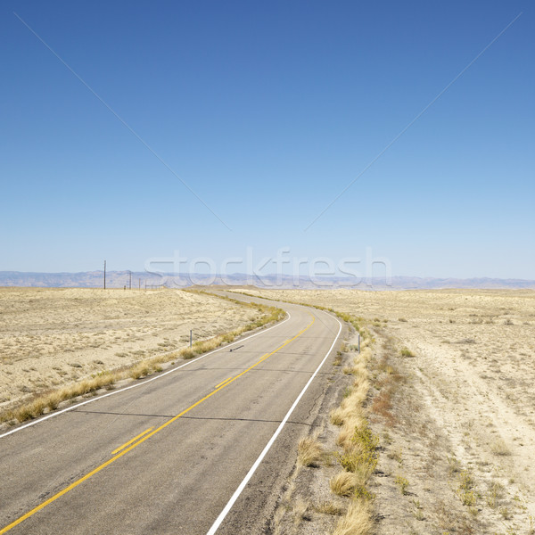 Road through barren landscape. Stock photo © iofoto