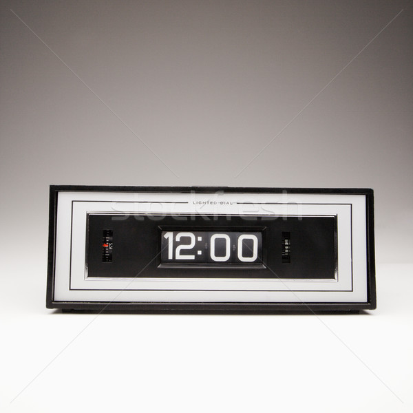 Stock photo: Retro clock set for 12:00.
