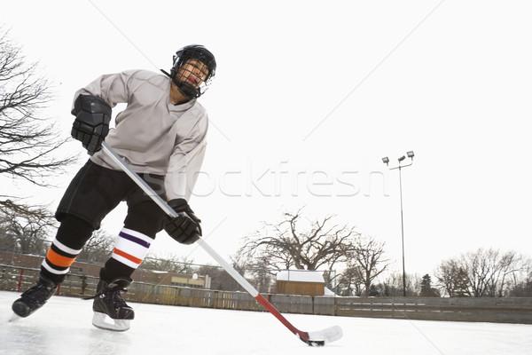 Stock photo: Boy playing ice hockey.