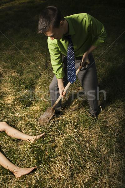 Biznesmen trup młodych łopata ciało na zewnątrz Zdjęcia stock © iofoto