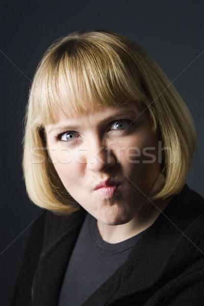 Woman grimacing. Stock photo © iofoto