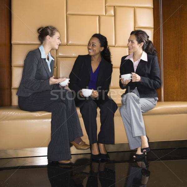 Stock photo: Businesswomen drinking coffee.