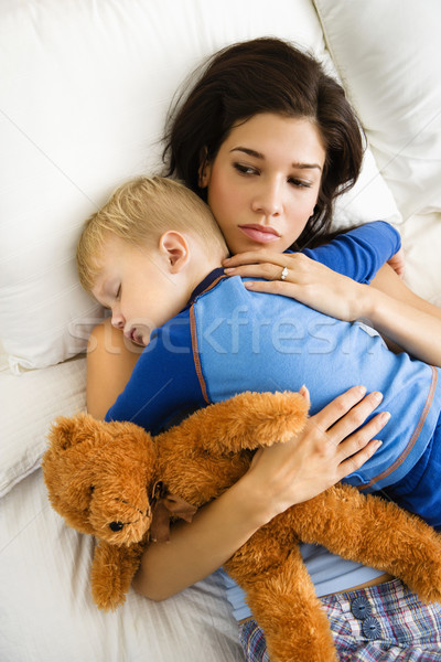 Mom with sleeping child. Stock photo © iofoto