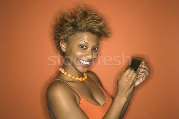 Kobieta pda portret uśmiechnięty młodych dorosły Zdjęcia stock © iofoto