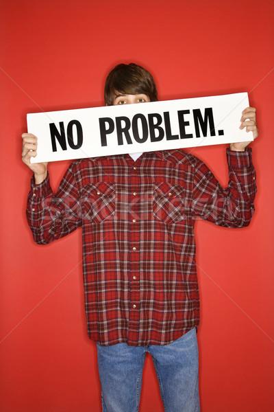 Boy holding sign. Stock photo © iofoto