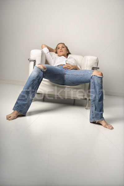 Young Woman Relaxing in Armchair Stock photo © iofoto