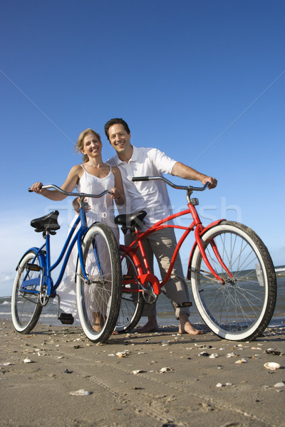Stock photo: Couple with Bikes at the Beach