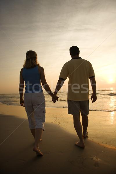çift plaj gün batımı kafkas yürüyüş el ele tutuşarak Stok fotoğraf © iofoto