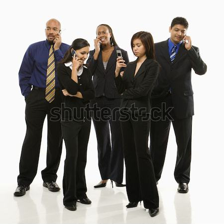Business group on cellphones. Stock photo © iofoto