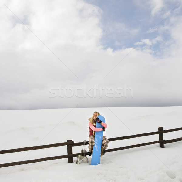 Stock photo: Woman with snowboard.