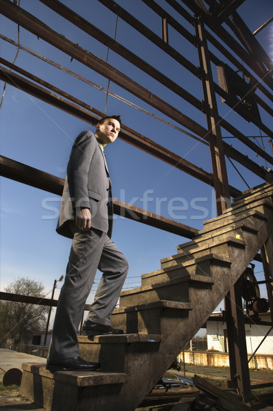 Young Businessman Walking Up Stairs Stock photo © iofoto
