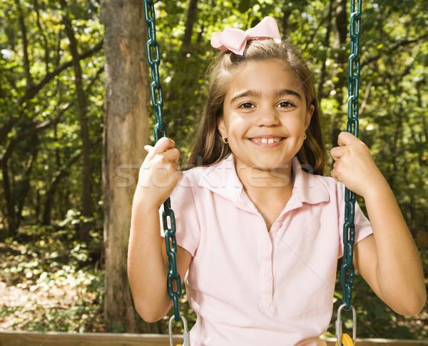 Meisje portret swing latino vergadering speeltuin Stockfoto © iofoto