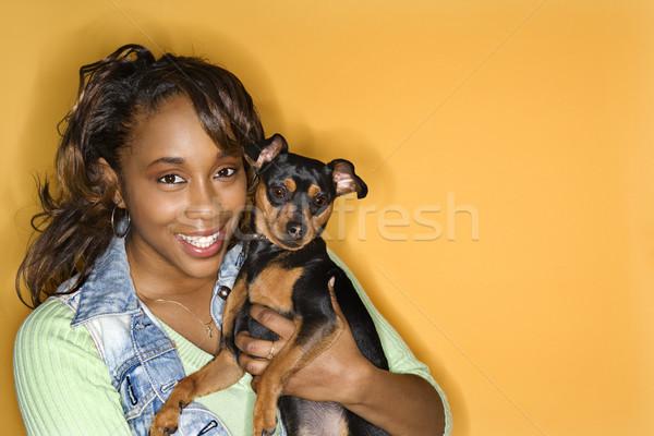 Woman holding small dog. Stock photo © iofoto