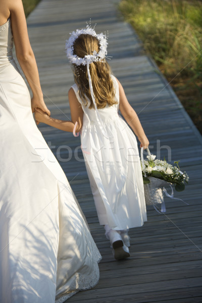 Bride and Flower Girl on Boardwalk Stock photo © iofoto