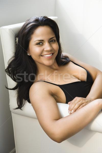 Donna seduta sedia ritratto sorridere ispanico Foto d'archivio © iofoto