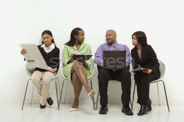 üzleti csoport több nemzetiségű férfiak nők ül néz Stock fotó © iofoto