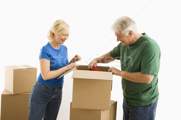 Man and woman packing. Stock photo © iofoto