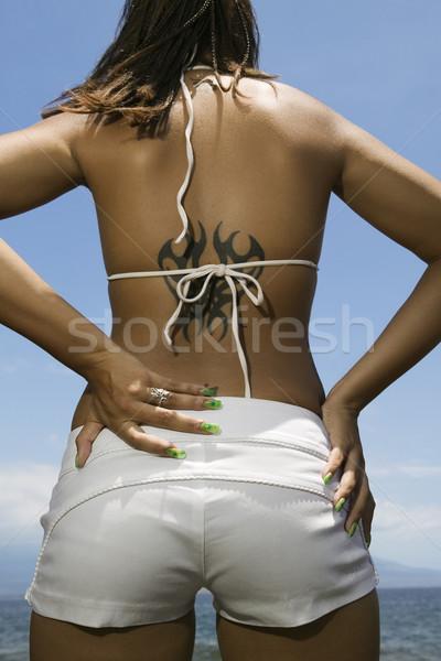 Donna spiaggia vista posteriore mani Foto d'archivio © iofoto