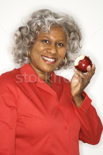 Woman eating apple. Stock photo © iofoto