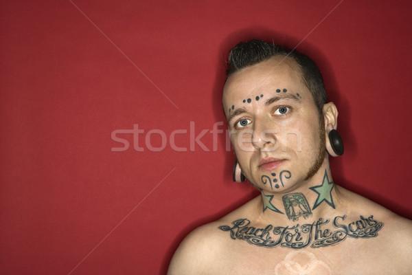 Homem tatuagens caucasiano homens retrato vermelho Foto stock © iofoto