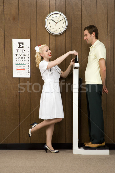 Nurse weighing man. Stock photo © iofoto