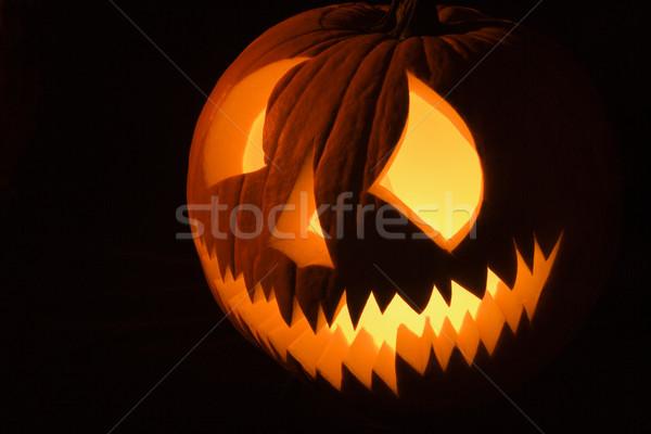 Carved pumpkin. Stock photo © iofoto