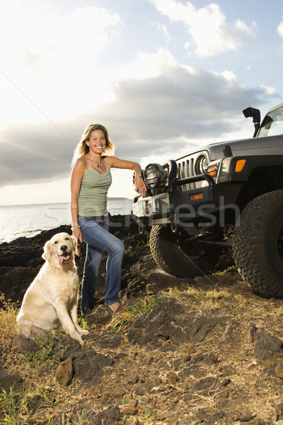 Woman and Dog by SUV at the Beach Stock photo © iofoto
