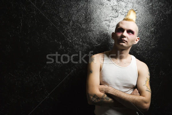 Punk with crossed arms. Stock photo © iofoto