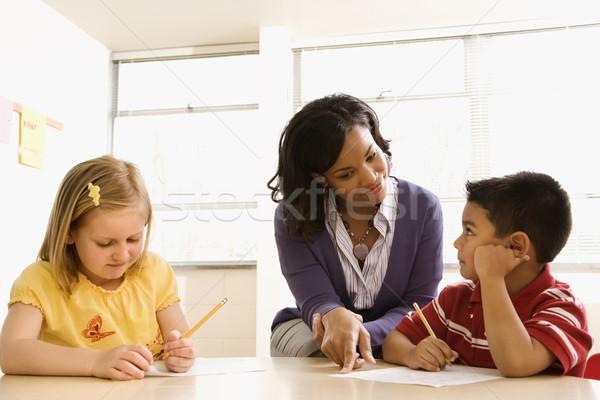Teacher Helping Students With Schoolwork  Stock photo © iofoto