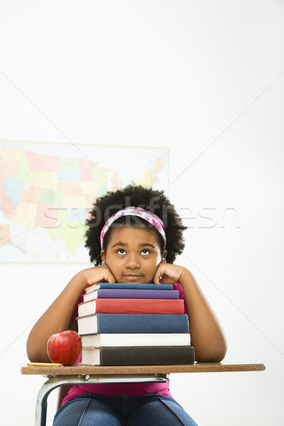 Bored girl with books. Stock photo © iofoto