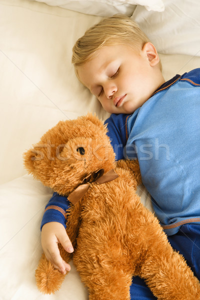 Baby sleeping with bear. Stock photo © iofoto