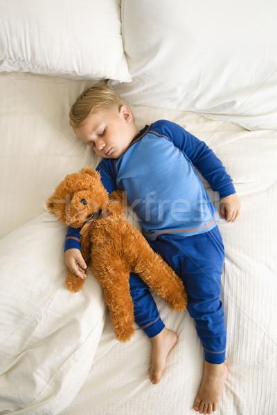 Stock photo: Toddler sleeping with bear.