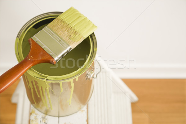 Paintbrush and can on ladder. Stock photo © iofoto