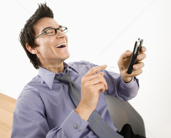 Man laughing at text message. Stock photo © iofoto