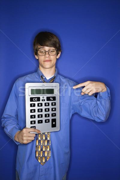 Boy holding huge calculator. Stock photo © iofoto