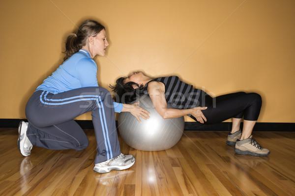 Nők egyensúlyozó labda nő másik hát tornaterem Stock fotó © iofoto