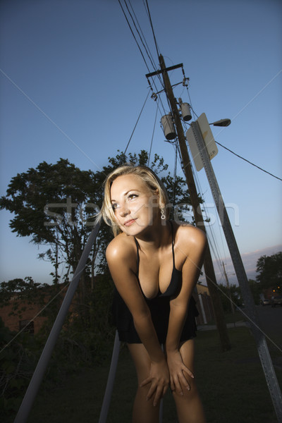 Flörtölő szőke nő kaukázusi visel kicsi fekete ruha Stock fotó © iofoto
