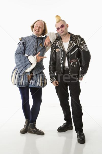 Fiatal punk férfi mosolyog dől gótikus Stock fotó © iofoto