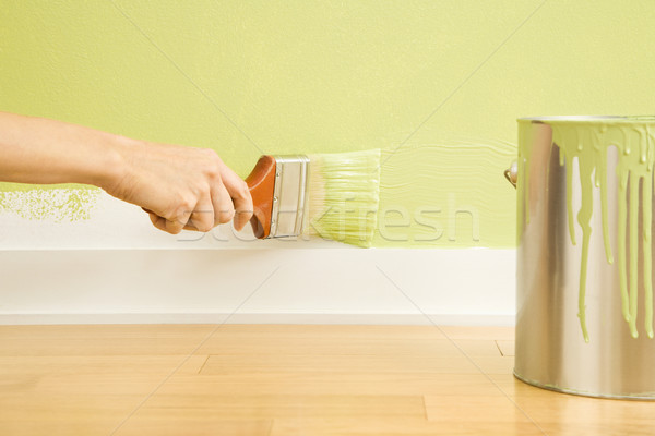 Woman painting trim. Stock photo © iofoto