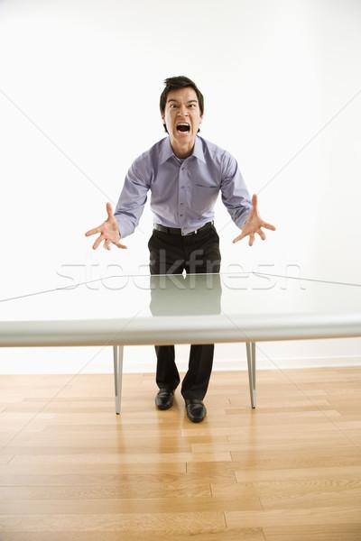 Angry businessman yelling. Stock photo © iofoto