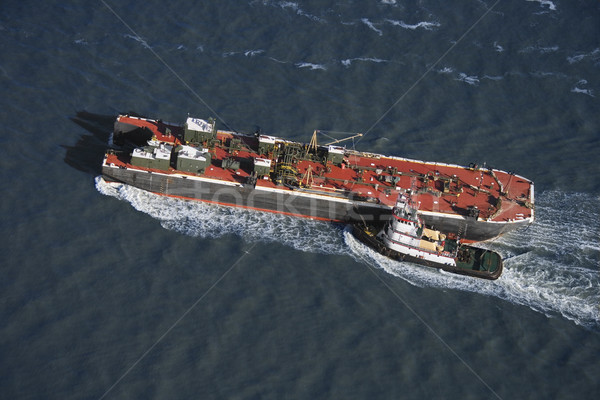 Tugboat pushing ship. Stock photo © iofoto